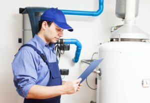 plumber repairing common water heater problems